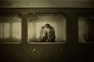 person grieving on a train